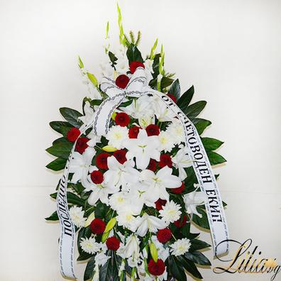 Funeral wreath with rose, lily, dahlia and gladiol